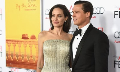 """HOLLYWOOD, CA - NOVEMBER 05:  Writer-director-producer-actress Angelina Jolie Pitt (L) and actor-producer Brad Pitt attend the opening night gala premiere of Universal Pictures' """"By the Sea"""" during AFI FEST 2015 presented by Audi at TCL Chinese 6 Theatres on November 5, 2015 in Hollywood, California.  (Photo by Kevin Winter/Getty Images)"""